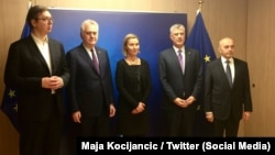 Left to right: Serbian Prime Minister Aleksandar Vucic; Serbian President Tomislav Nikolic; EU foreign policy chief Federica Mogherini; Kosovar President Hashim Thaci; and Kosovar Prime Minister Isa Mustafa in Brussels on February 1