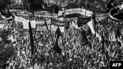 National Front of Iran (Jebhe Melli) supporters demonstrate, in Tehran, July 25, 1953 in support of Prime Minister Mohammad Mossadegh.