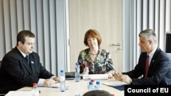European Union foreign-policy chief Catherine Ashton (center) met with the Serbian and Kosovar prime ministers, Ivica Dacic (left) and Hashim Thaci, in Brussels.