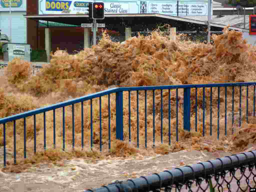 This photo taken on January 10, 2011 shows flood waters surging through streets, inundating the city of Toowoomba.