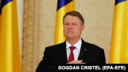 ROMANIA -- Romania's President Klaus Iohannis listens to the national anthem at Cotroceni Presidential palace in Bucharest, Romania, 04 January 2017