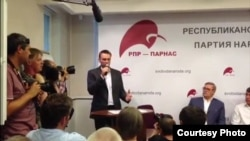 Aleksei Navalny (center) addressed the meeting after winning its nomination