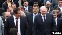 Armenia - Belarusian President Aleksandr Lukashenko (R) and businessman Gagik Tsarukian attend the opening of a new church in Abovian, 14May2013.