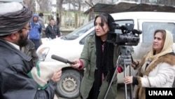 Afghanistan -- Afghan journalists at work in Kabul.