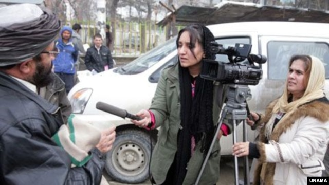 Afghanistan -- Afghan journalists at work in Kabul.