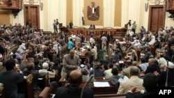 The defiant parliament meets in Cairo on July 10.