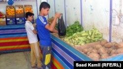 احد محلات بيع الخضار في بغداد