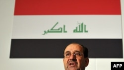 "Iraqi Prime Minister Nuri al-Maliki addresses delegates during the ""Invest Iraq 2009"" conference in London on April 30."