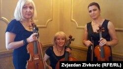 S lijeva na desno: Sanja Svrdlin, Bogumila Kamenjašević i Etleva Karadža sa novim gudačkim instrumentima