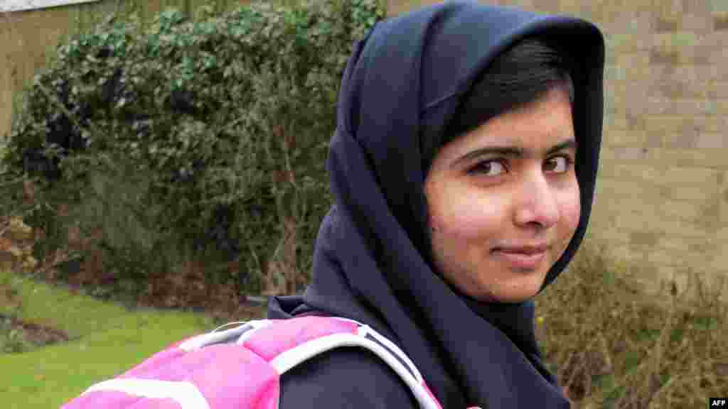 "Pakistani schoolgirl Malala Yousafzai is pictured holding a backpack in Birmingham, England, before returning to school for the first time since she was shot in the head by the Taliban in October 2012 for campaigning for girls' education. The 15-year-old said she had ""achieved her dream"" and was looking forward to meeting new friends at the Edgbaston High School for Girls in Birmingham, where she is now living. Malala was flown to Britain after the attack for surgery for her head injuries and underwent several operations. (AFP/Malala Press Office)"