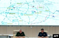 """Брифинг Минобороны 21 июля 2014 года, на котором были представлены сфальсифицированные спутниковые снимки района катастрофы """"Боинга"""", доказывающие, что он мог быть сбит украинским """"Буком"""""""
