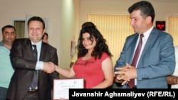 Azrbaijan -- Radio Azadliq reporter Durna Safarli receiving award for human trafficking coverage in Azerbaijan, 12Jun2012