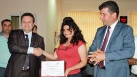 Azrbaijan -- Radio Azadliq reporter Durna Safarli receiving award for human trafficking coverage in Azerbaijan, 12Jun2012