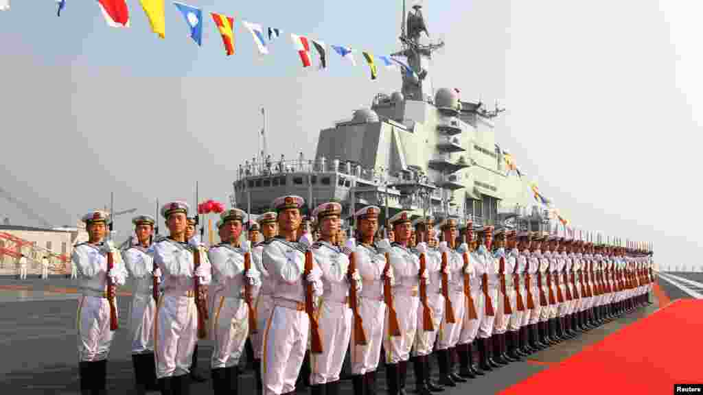 """Chinese naval honor guards stand as they wait for an inspection on the """"Liaoning"""" aircraft carrier in Dalian, Liaoning Province on September 25. (REUTERS/Xinhua/Zha)"""