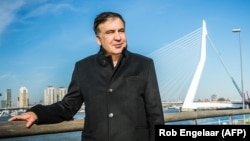 Former Georgian President Mikheil Saakashvili poses in front of the Erasmus Bridge in Rotterdam. (file photo)