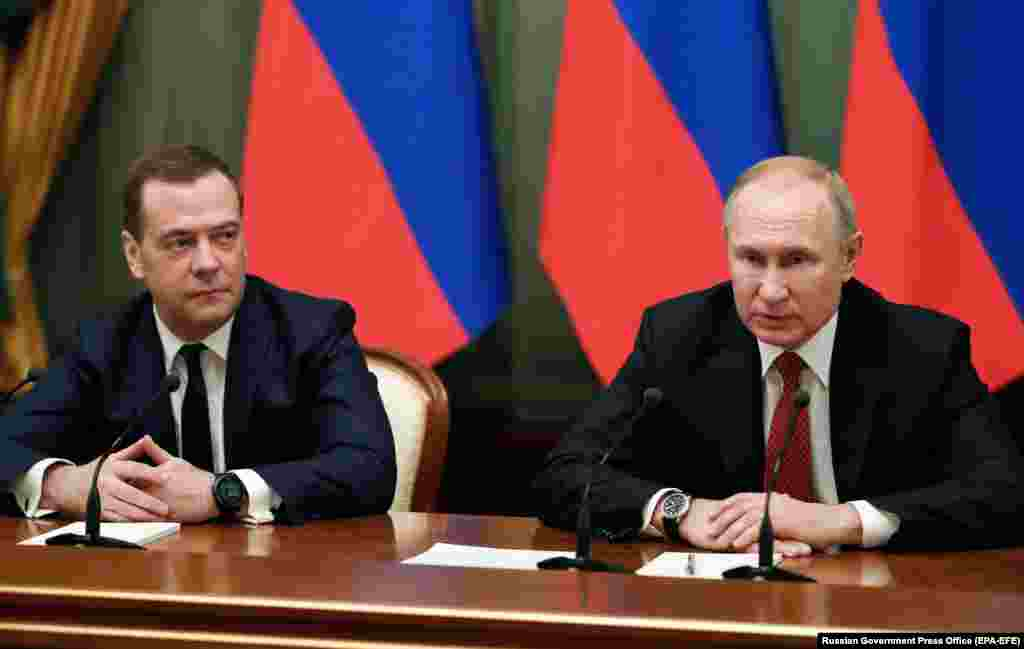 Putin and Medvedev meet with members of the government in Moscow on January 15, 2020. Putin used his annual state-of-the-nation speech to call for a referendum on substantial constitutional amendments that would strengthen parliament's powers before his term ends in 2024. Hours later, Medvedev and his cabinet resigned.