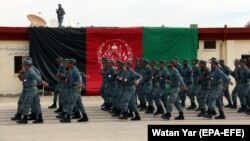 Afghan policemen march during a graduation ceremony earlier this month.