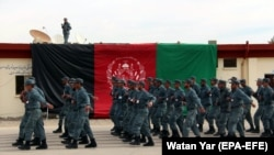Afghan policemen march during a graduation ceremony in Helmand on February 6.