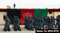 Afghan police officers march during a graduation ceremony.