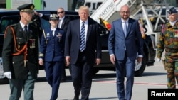 U.S. President Donald Trump (center) walks beside Belgian Prime Minister Charles Michel (right) upon arriving at Brussels airport on May 24.