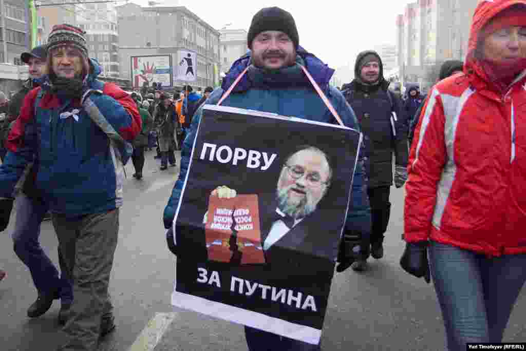 "Central Election Commission head Vladimir Churov is pictured ripping up the constitution saying, ""I tear up for Putin,"" a reference to the Putin Army -- attractive young women who tear off their clothes for Putin."