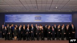 Belgium -- European Union heads of state and officials pose for a family photo at the EU headquarters in Brussels on March 20, on the first day of a two-day European Council summit.