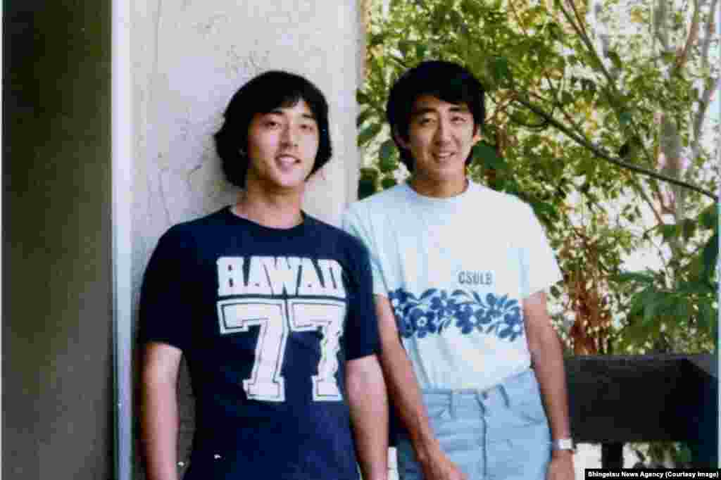 Japan's Prime Minister Shinzo Abe (right) during his time studying public policy at the University of Southern California
