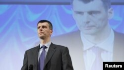 Mikhail Prokhorov addresses supporters at a meeting in Moscow on December 15.