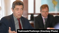 Volodymyr Sokolov (left) and Oleh Lebedev say the Korea report has not hurt Yuzhmash's business.