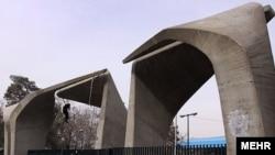Iran -- A man cleans entrance gateway of Tehran University, Tehran, 03Jan2010