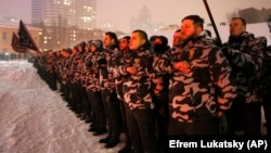 Volunteers of the right-wing paramilitary Azov Civil Corps swear an oath of allegiance in central Kyiv on January 28.