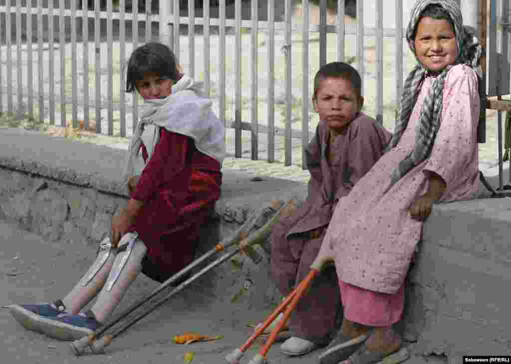 Disabled children beg on a Kabul street.