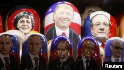 Russia -- Painted Matryoshka dolls, or Russian nesting dolls, bearing the faces of German Chancellor Angela Merkel, US Republican presidential nominee Donald Trump, French President Francois Hollande and Russian President Vladimir Putin are displayed for