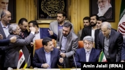Interior ministers of Iran and Iraq signing an agreement on sending pilgrims to Iraq. Sunday August 13, 2017.