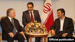 Iranian President Mahmud Ahmadinejad (right) with Armenian Foreign Minister Edward Nalbandian (left) in Tehran on September 17