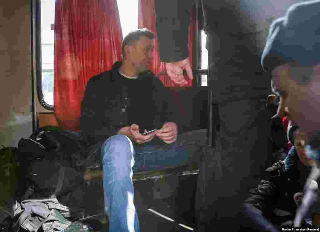Navalny sitting in a police van after being seized by police during a massive Moscow rally in March 2017. He was fined $350 for taking part in what the authorities called an illegal protest.
