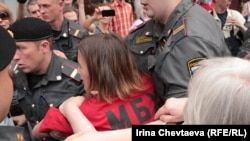 Police arrest activists at the rally in Moscow