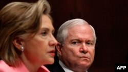 U.S. Secretary of State Hillary Clinton (left) testifies before the Senate Foreign Relations Committee with Defense Secretary Robert Gates about the new START treaty.
