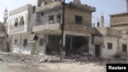 Shtëpitë e dëmtuara në një lagje të qytetit Homs