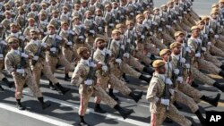 Iranian troops march on the 39th anniversary of the Iran-Iraq war before shrine to the late revolutionary founder Ayatollah Khomeini, just outside Tehran, Sunday, Sept. 22, 2019. FILE Photo