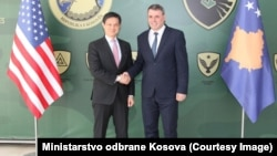 Deputy U.S. Assistant Secretary of State Hoyt Brian Yee (left) and the minister for Kosovo's security forces, Haki Demolli, in Pristina on March 29