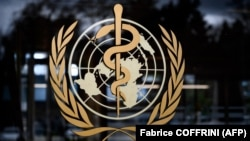 A picture taken on March 9, 2020 shows the sign of the World Health Organization (WHO) at the WHO headquarters in Geneva.