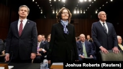 FBI Director Christopher Wray (left to right), CIA Director Gina Haspel, and Director of National Intelligence Dan Coats arrive with other U.S. intelligence community officials to testify before a Senate Intelligence Committee hearing in Washington on January 29.