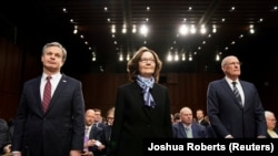 "FBI Director Christopher Wray; CIA Director Gina Haspel and Director of National Intelligence Dan Coats arrive to testify before a Senate Intelligence Committee hearing on ""worldwide threats"". January 29, 2019"