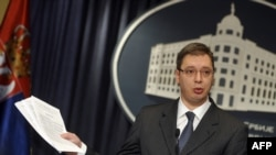 Serbia -- First Deputy Prime Minister Aleksandar Vucic holds documents during a press conference in Belgrade, 30Mar2013