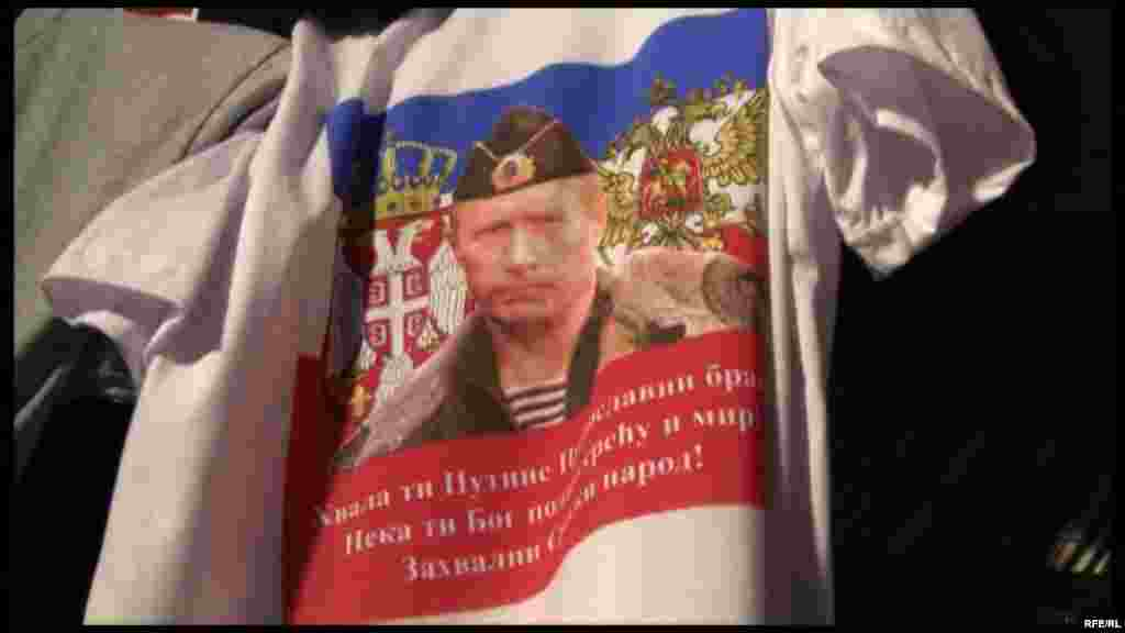 A closer look: Putin in uniform superimposed on the Russian and Serbian heraldic eagles