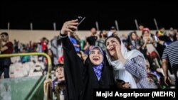 Iranian football fans in Iran watching Iran Spain game via screen