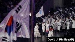 Төньяк һәм Көньяк Корея спортчылары бергә чыкты