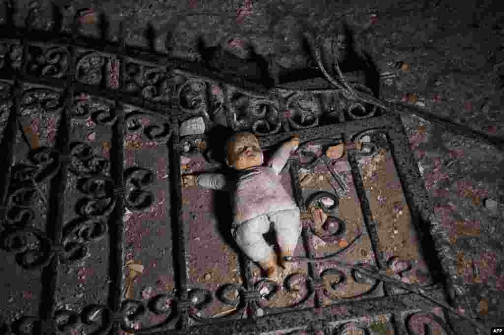 A doll lies on the ground at the entrance to a destroyed house following clashes between Macedonian police and an armed group in Kumanovo.