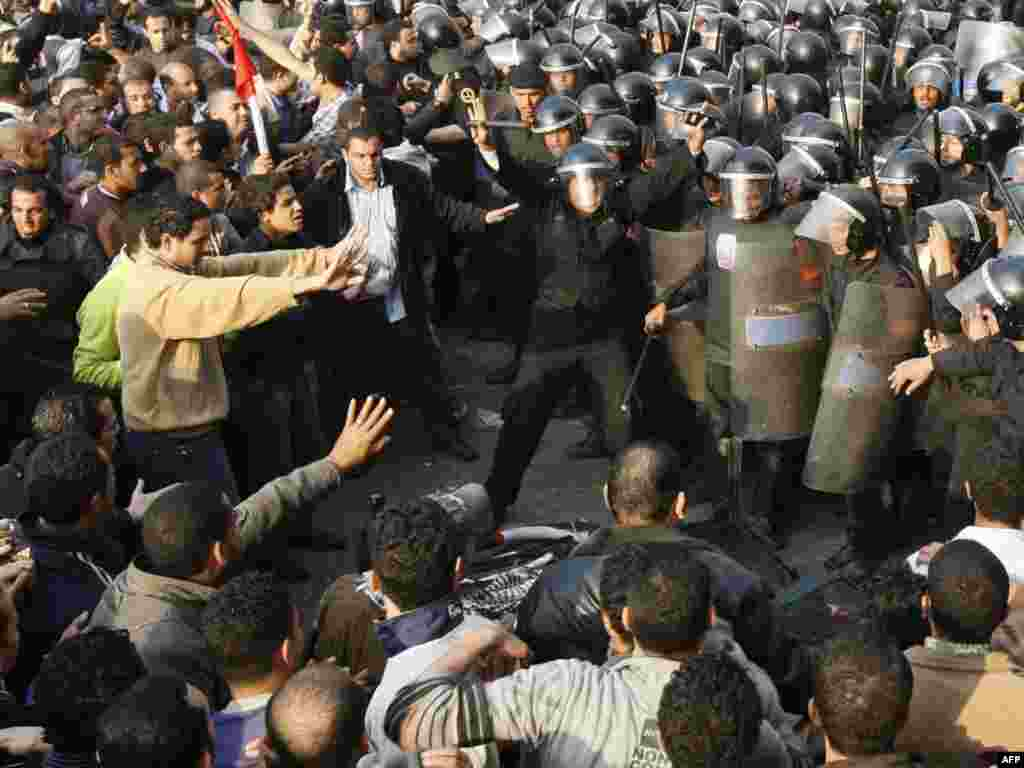 Demonstrators clash with police in central Cairo on January 25